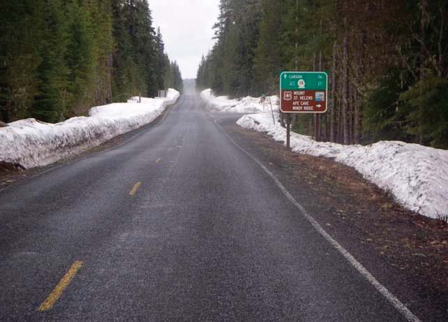 Figure 12. Photo. This Photo Shows A Roadway With Snow On The Shoulders,