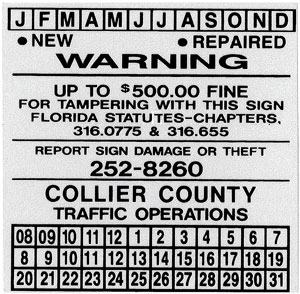 Image. A scanned image of a sign dating label with an anti-theft warning is shown.
