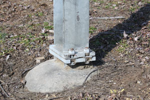 This photos depicts a close up of the base of the posts.
