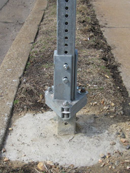 Photo of example breakaway square steel posts is shown. This is a photo of a slip coupling.