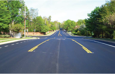 In this application, a 3-lane configuration transitions to a 2-lane configuration by eliminating the two-way left-turn lane immediately after the final left turn.