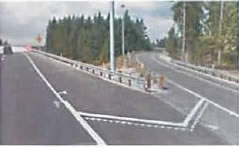 Figure 3.  Photo.  Example of a crash cushion.  This photo shows a crash cushion installed at Exit Ramp 1B. A speed warning sign denotes the ramp is 40 miles per hour.